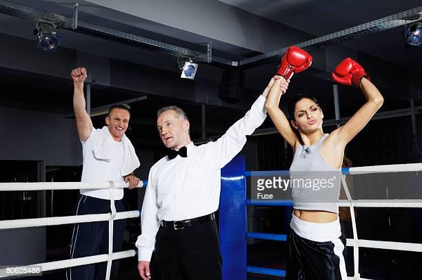 Referee Raising Arm of Winner