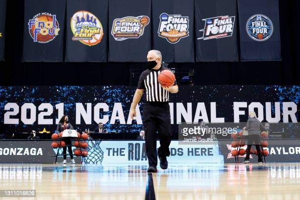 Referee Randy McCall holds a ball in the National Championship game of the 2021 NCAA Men's Basketball Tournament at Lucas Oil Stadium on April 05,...
