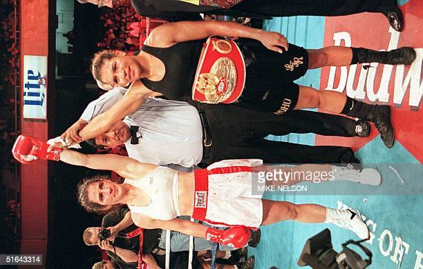 Referee Raoul Caiz holds up the arms of women boxers Lucia Rijker of Holland and Jeanette Witte of Germany after Rijker knocked out Witte in the...