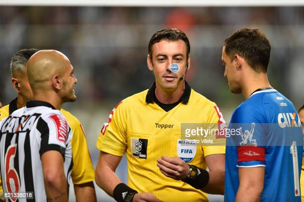 Referee Raphael Claus oversees the coin toss before the match between Atletico MG and Vasco da Gama as part of Brasileirao Series A 2017 at...