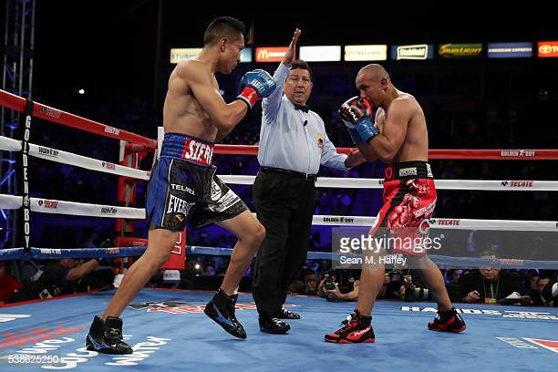 Referee Raul Caiz Sr seperates Orlando Salido and Francisco Vargas during their WBC super featherweight championship bout at StubHub Center on June 4...