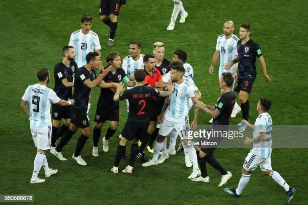 Referee Ravshan Irmatov intervenes as Croatia and Argentina players clash after Nicolas Otamendi of Argentina kicks the ball into Ivan Rakitic of...