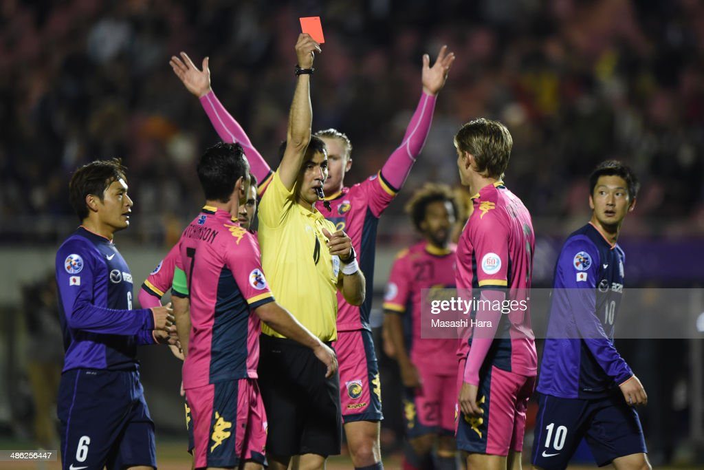 Referee Ravshan Irmatov shows Red card to Brent Griffiths #6 of Central coast mariners during the AFC Champions League Group F match between Sanfrecce Hiroshima and Central Coast Mariners at Edion Stadiam Hiroshima on April 23, 2014 in Hiroshima, Japan.