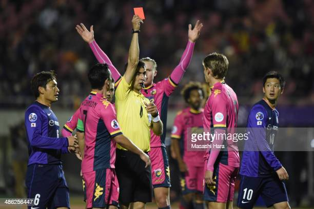 Referee Ravshan Irmatov shows Red card to Brent Griffiths of Central coast mariners during the AFC Champions League Group F match between Sanfrecce...