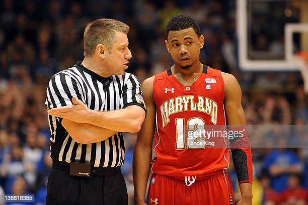 Referee Ray Natili talks to Terrell Stoglin of the Maryland Terrapins during a stop in play against the Duke Blue Devils at Cameron Indoor Stadium on...