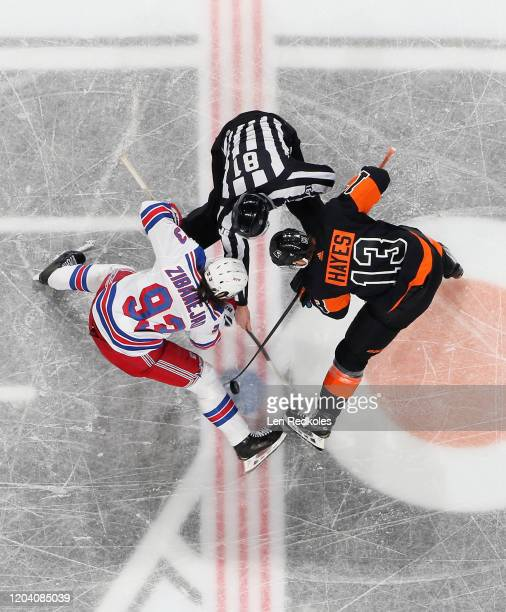 Referee Rayn Daisy drops the puck during a faceoff between Kevin Hayes of the Philadelphia Flyers and Mika Zibanejad of the New York Rangers on...