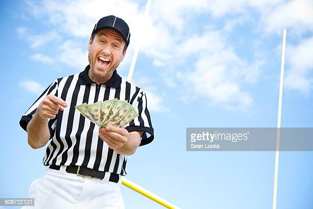 referee: ref with money fan - american football referee stock pictures, royalty-free photos & images
