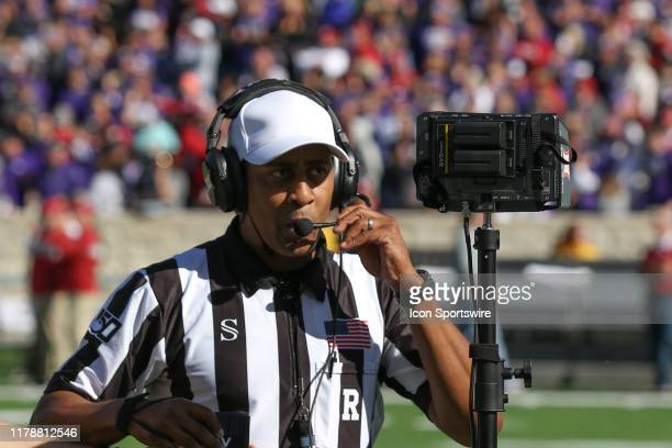 Referee Reggie Smith prepares for a video review of an on-side kick recovered by the Sooners with 1:45 left in the fourth quarter of a Big 12...