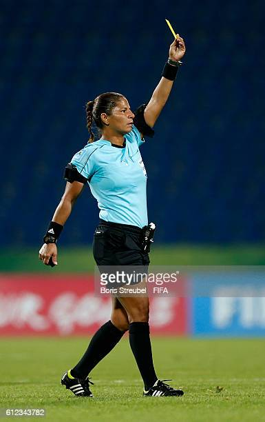 Referee Regildenia Holanda de Moura shows a yellow card during the FIFA U17 Women's World Cup Jordan Group B match between Germany and Canada at...