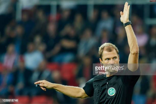Referee Rene Rohde gestures during the Second Bundesliga match between SSV Jahn Regensburg and SG Dynamo Dresden on September 14 2018 in Regensburg...