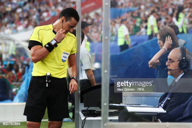 Referee reviews the VAR footage during the FIFA Confederations Cup Russia 2017 Group B match between Germany and Cameroon at Fisht Olympic Stadium on...