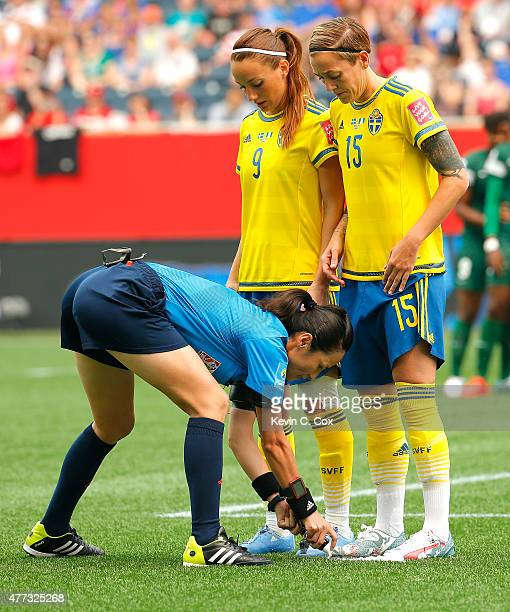Referee Ri Hyang Ok of Korea DPR in action during the FIFA Women's World Cup Canada 2015 Group D match between Sweden and Nigeria at Winnipeg Stadium...