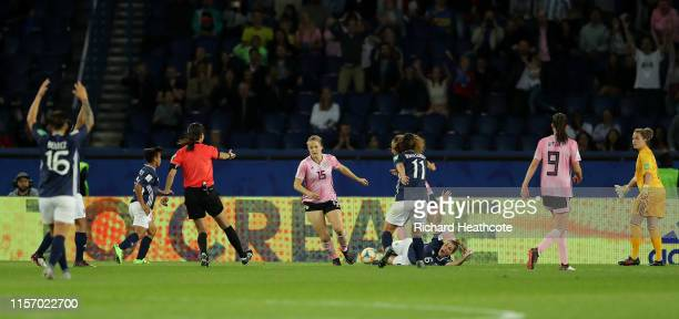 Referee Ri Hyang Ok turns away the initial penalty appeal before over turning the decision after reviewing the VAR during the 2019 FIFA Women's World...