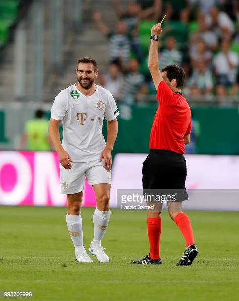 Referee Ricardo De Burgos shows the yellow card for Daniel Bode of Ferencvarosi TC during the UEFA Europa League First Qualifying Round 1st Leg match...