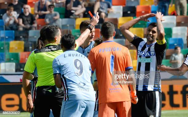 referee Riccardo Pinzani shows red card to Luis Fernando Muriel of UC Sampdoria and Danilo Larangeira of Udinese Calcio during the Serie A match...