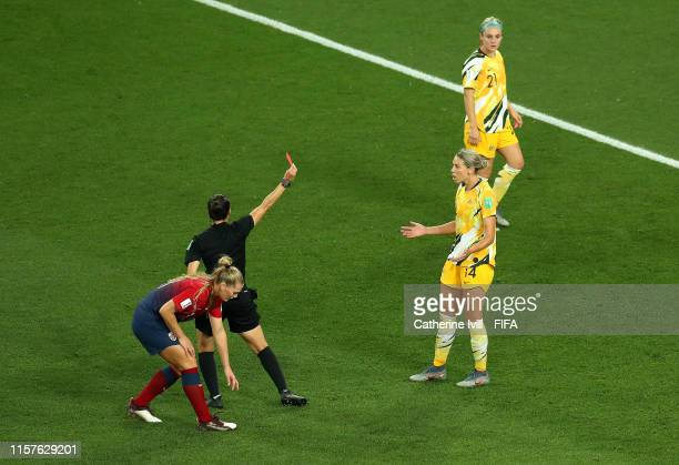 Referee Riem Hussein shows Alanna Kennedy of Australia a red card during the 2019 FIFA Women's World Cup France Round Of 16 match between Norway and...