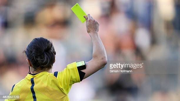 Referee Riem Hussein shows the yellow card during the 3 Liga match between 1 FSV Mainz 05 II and 1 FC Magdeburg at Bruchweg Stadium on July 31 2015...