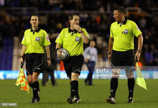 Referee Rob Lewis and his assistant Amy Fearn