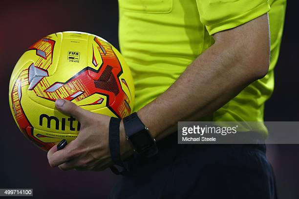 Referee Rob Madley carries the match ball ahead of the Capital One Cup Quarter Final match between Southampton and Liverpool at St Mary's Stadium on...