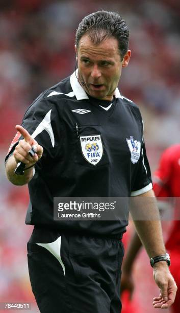 Referee Rob Styles gestures during the Barclays Premier League match between Middlesbrough and Birmingham City at the Riverside Stadium on September...