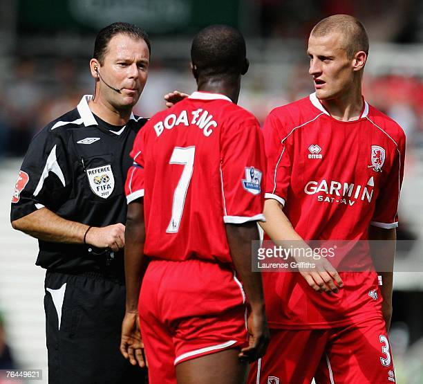 Referee Rob Styles talks with George Boateng of Middlesbrough during the Barclays Premier League match between Middlesbrough and Birmingham City at...