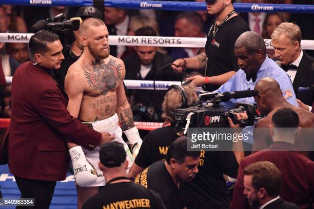 Referee Robert Byrd giving instructions to Floyd Mayweather Jr and Conor McGregor before their super welterweight boxing match on August 26 2017 at...