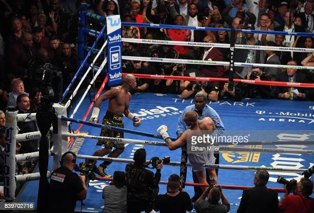 Referee Robert Byrd stops the fight in round 10 with a TKO of Conor McGregor by Floyd Mayweather Jr in their super welterweight boxing match on...
