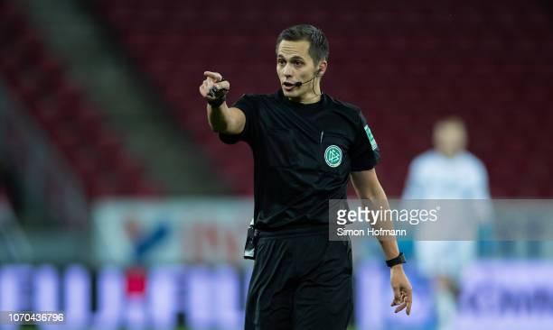 Referee Robert Hartmann gestures during the Bundesliga match between 1 FSV Mainz 05 and Hannover 96 at Opel Arena on December 9 2018 in Mainz Germany