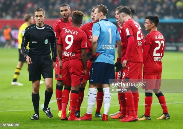 Referee Robert Hartmann speaks with Jonathan Tah of Leverkusen Leon Bailey of Leverkusen Sven Bender of Leverkusen Bernd Leno of Leverkusen Lars...