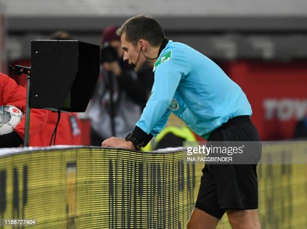 Referee Robert Hartmann watches at a monitor for Video Assist VAR during the German first division Bundesliga football match Fortuna Dusseldorf v RB...