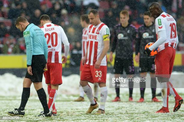 Referee Robert Kampka Salih Oezcan of Koeln Matthias Lehmann of Koeln and Sehrou Guirassy of Koeln look on during the Bundesliga match between 1 FC...