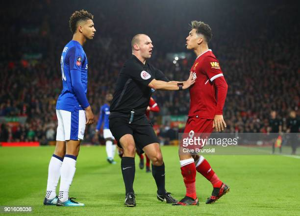 Referee Robert Madley intervenes as Mason Holgate of Everton and Roberto Firmino of Liverpool clash during the Emirates FA Cup Third Round match...
