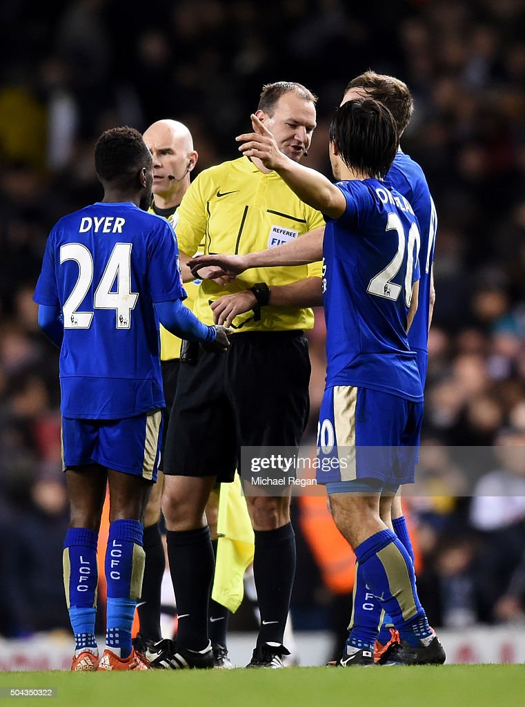 Referee Robert Madley is surrounded by Leicester players protesting the validity of the late penalty awarded to Tottenham during The Emirates FA Cup third round match between Tottenham Hotspur and Leicester City at White Hart Lane on January 10, 2016 in London, England.