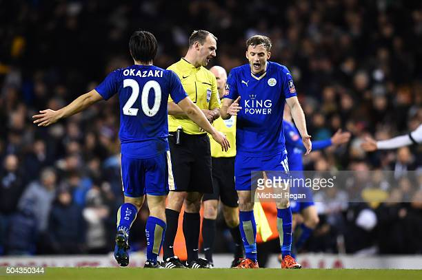 Referee Robert Madley is surrounded by Leicester players protesting the validity of the late penalty awarded to Tottenham during The Emirates FA Cup...