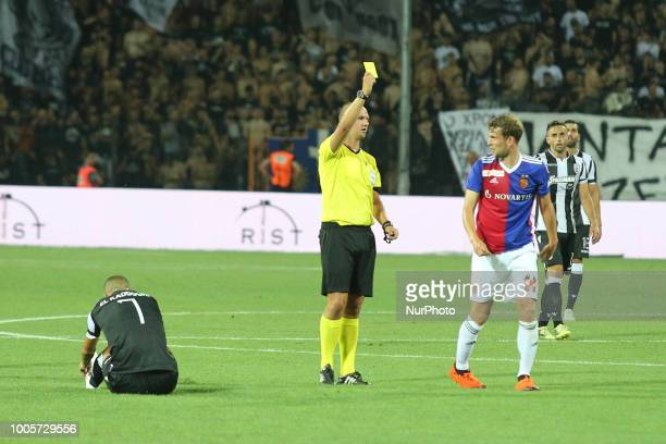 Referee ROBERT MADLEY show a yellow card to a FC Player during Champions League second qualifying round first leg football match between PAOK FC and...