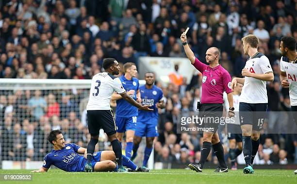 Referee Robert Madley shows Danny Rose of Tottenham Hotspur a yellow card after a foul on Shinji Okazaki of Leicester City during the Premier League...