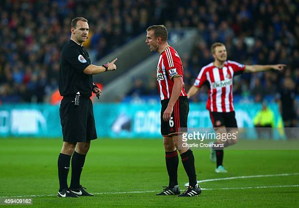 Referee Robert Madley talks to Lee Cattermole of Sunderland during the Barclays Premier League match between Leicester City and Sunderland at The...