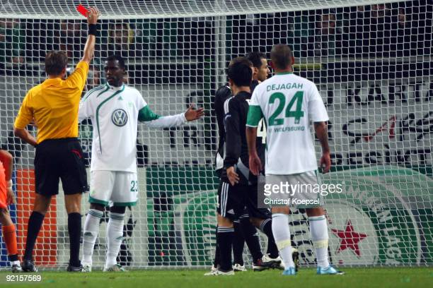 Referee Roberto Rosetti of Italy shows Grafite of Wolfsburg the red card during the UEFA Champions League Group B first leg match between VfL...