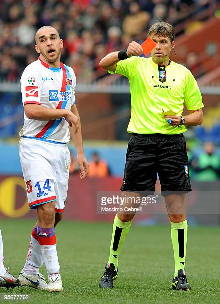 Referee Roberto Rosetti shows a red card to Giuseppe Bellusci of Catania Calcio during the Serie A match between Genoa CFC and Catania Calcio at...