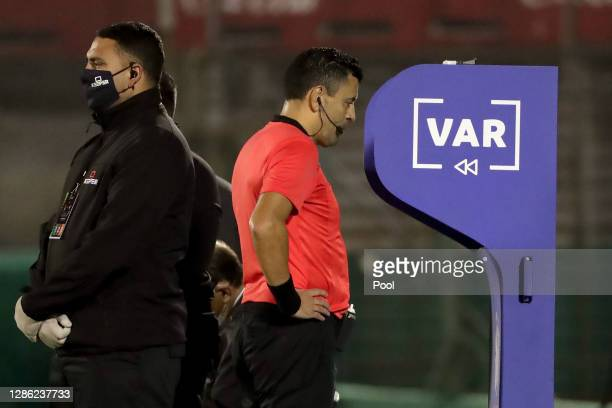 Referee Roberto Tobar checks the VAR during a match between Uruguay and Brazil as part of South American Qualifiers for World Cup FIFA Qatar 2022 at...