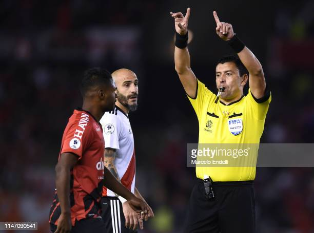 Referee Roberto Tobar of Chile gestures the VAR during the second leg match of the final of the CONMEBOL Recopa Sudamericana 2019 between River Plate...