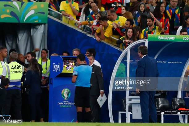 Referee Roberto Tobar reviews the VAR and calls on a penalty for Brazil during the Copa America Brazil 2019 Final match between Brazil and Peru at...
