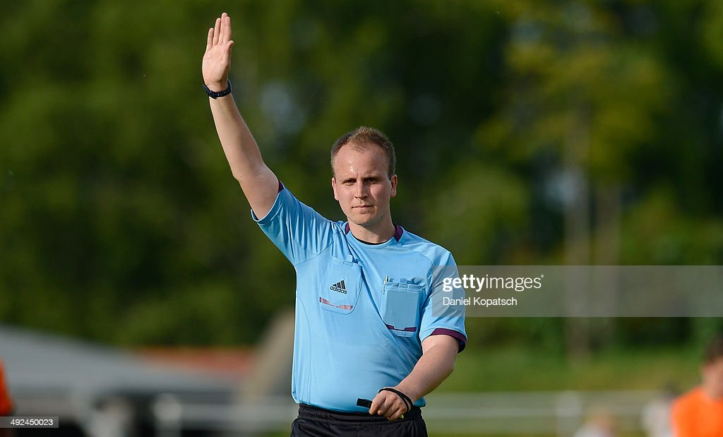 Referee Robin Siegl reacts during the international friendly U15 match between Germany and Netherlands on May 20, 2014 in Weingarten, Germany.
