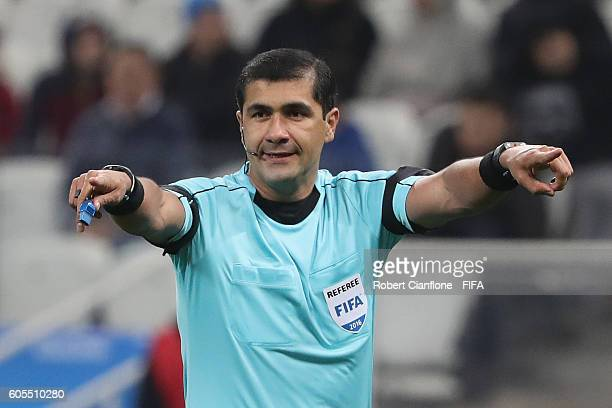 Referee Roddy Zambrano gestures during the Men's First Round Group A match between South Africa and Iraq on Day 5 of the Rio 2016 Olympic Games at...