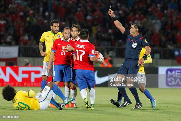 Referee Roddy Zambrano show a yellow card to Marcelo Diaz of Chile during a match between Chile and Brazil as part of FIFA 2018 World Cup Qualifier...