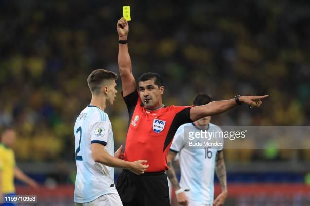 Referee Roddy Zambrano shows a yellow card to Juan Foyth of Argentina during the Copa America Brazil 2019 Semi Final match between Brazil and...