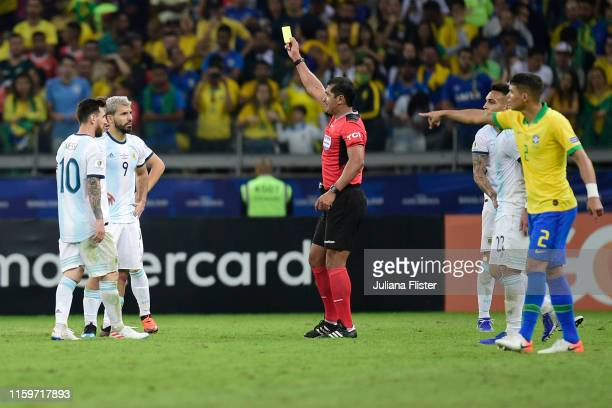 Referee Roddy Zambrano shows a yellow card to Sergio Aguero of Argentina during the Copa America Brazil 2019 Semi Final match between Brazil and...
