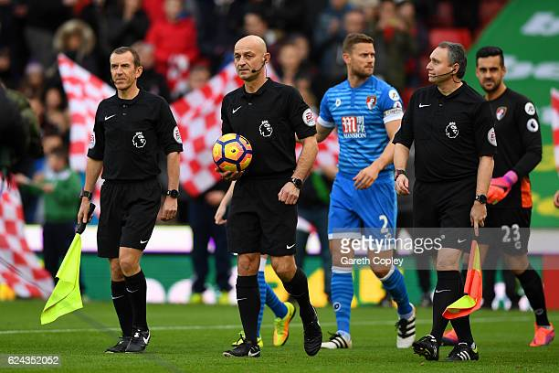 Referee Roger East and his two assistants Derek Eaton and Darren Cann walk out onto the pitch prior to kick off during the Premier League match...