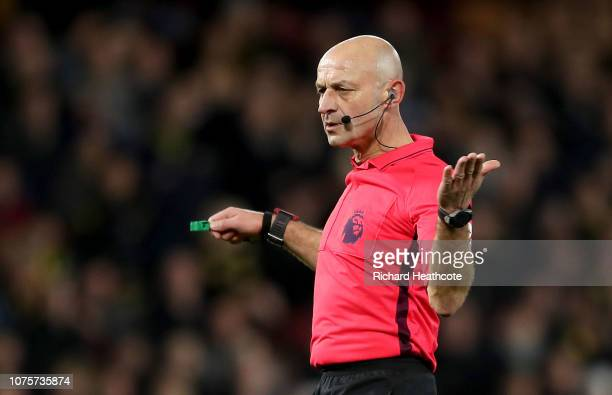 Referee Roger East gestures during the Premier League match between Watford FC and Newcastle United at Vicarage Road on December 29 2018 in Watford...