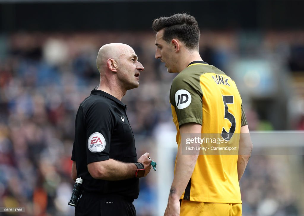 Referee Roger East has words with Brighton & Hove Albion's Lewis Dunk during the Premier League match between Burnley and Brighton and Hove Albion at Turf Moor on April 28, 2018 in Burnley, England.